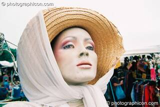 Female mannequin wearing hat and headscarf as if on a strole at Big Green Gathering 2003. Cheddar, Great Britain. © 2003 Photographicon