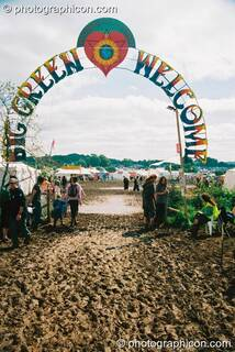 The well-trodden muddy path to the welcoming entrance of Big Green Gathering 2003. Cheddar, Great Britain. © 2003 Photographicon
