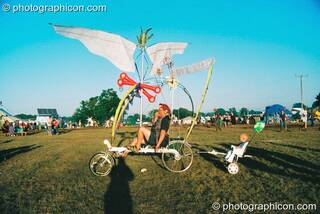 Professor Des Kay takes his son for a ride in his bicycle-drawn chariot at Big Green Gathering 2003. Cheddar, Great Britain. © 2003 Photographicon