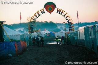 Leaving via the welcome gate as the early morning mist rises at Big Green Gathering 2003. Cheddar, Great Britain. © 2003 Photographicon