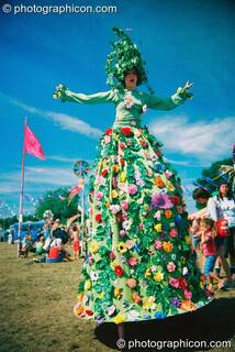 Stilted woman in big carnival dress at Big Green Gathering 2003. Cheddar, Great Britain. © 2003 Photographicon