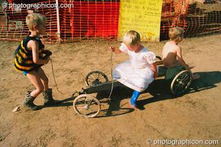 Kids playing on a go-cart at Big Green Gathering 2003. Cheddar, Great Britain. © 2003 Photographicon