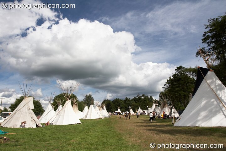 Giant cloud over an avenue of tipis at Big Green Gathering 2005. Burrington, Cheddar, Great Britain. © 2005 Photographicon