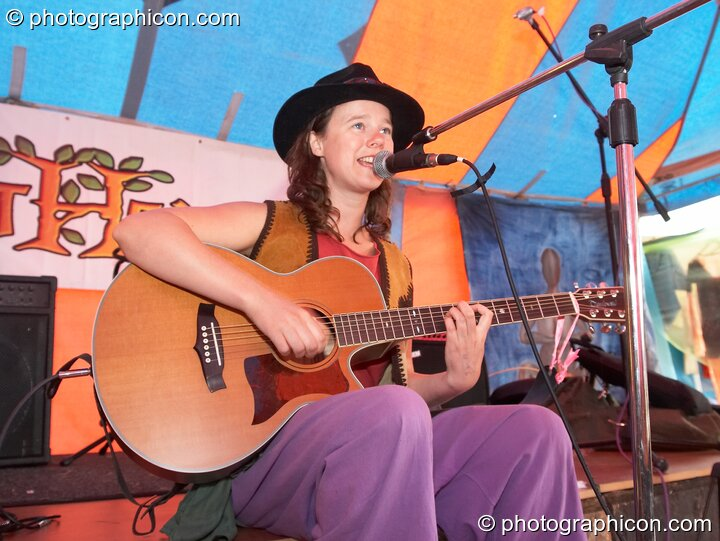 A singer performs on the Eartheart stage at Big Green Gathering 2006. Burrington, Cheddar, Great Britain. © 2006 Photographicon