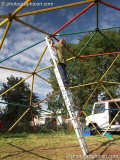 De-rigging a geodesic dome in the Campaigns field at Big Green Gathering 2006. Burrington, Cheddar, Great Britain. © 2006 Photographicon
