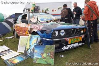 A decoratively painted BMW car forms part of an art stall at Big Green Gathering 2007. Burrington, Cheddar, Great Britain. © 2007 Photographicon