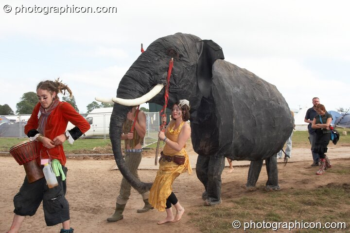 A circus troop lead a pantomime elephant around Big Green Gathering 2007. Burrington, Cheddar, Great Britain. © 2007 Photographicon
