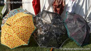 A collection of beautifully painted parasols at Big Green Gathering 2007. Burrington, Cheddar, Great Britain. © 2007 Photographicon