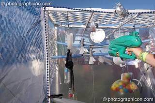 A fairground water-pistol game at Big Green Gathering 2007. Burrington, Cheddar, Great Britain. © 2007 Photographicon