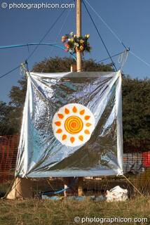 A person takes uses the solar showers at Big Green Gathering 2007. Burrington, Cheddar, Great Britain. © 2007 Photographicon