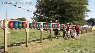 A group of youths turn the Tibetan Buddhist prayer wheels in the Healing Field at Big Green Gathering 2007. Burrington, Cheddar, Great Britain. © 2007 Photographicon