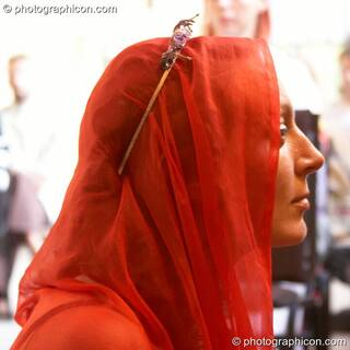 Woman in red head-scarf at the Feast of the Magdalene. Glastonbury, Great Britain. © 2005 Photographicon