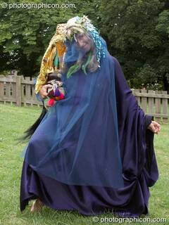 Woman in blue dress carrying a figurine of Magdalene at the Feast of the Magdalene. Glastonbury, Great Britain. © 2005 Photographicon