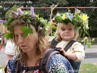 Woman and child wearing a flower head-dress at the Feast of the Magdalene. Glastonbury, Great Britain. © 2005 Photographicon