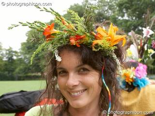 Woman wearing a flower head-dress at the Feast of the Magdalene. Glastonbury, Great Britain. © 2005 Photographicon