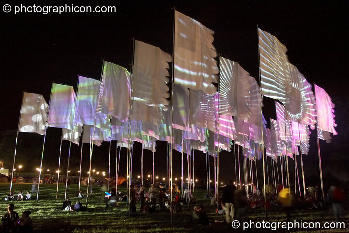 Projections by night on group of large flags at Glade Festival 2005. Aldermaston, Great Britain. © 2005 Photographicon