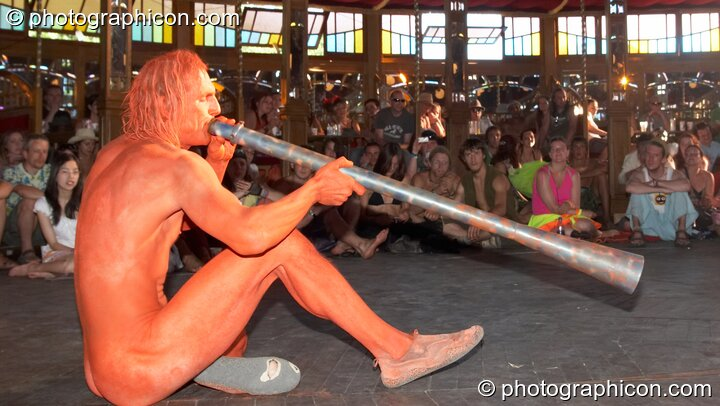 Naked Jovis plays a didgeridoo in the nude in the Pussy Parlure at Glade Festival 2006. Aldermaston, Great Britain. © 2006 Photographicon