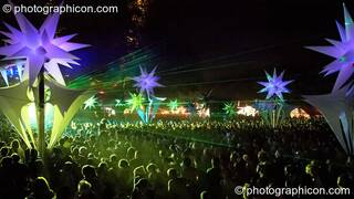 A night view from above the crowd of dancers amongst the illuminated inflatable Tribe of Frogs decor by the Origin Stage at Glade Festival 2006. Aldermaston, Great Britain. © 2006 Photographicon