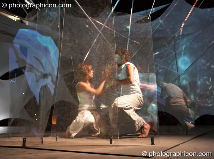 Mira WeMoonSpiral and Tom Peto of Arcescape perform a dance of light on the IDSpiral outdoor stage at Glade Festival 2006. Aldermaston, Great Britain. © 2006 Photographicon