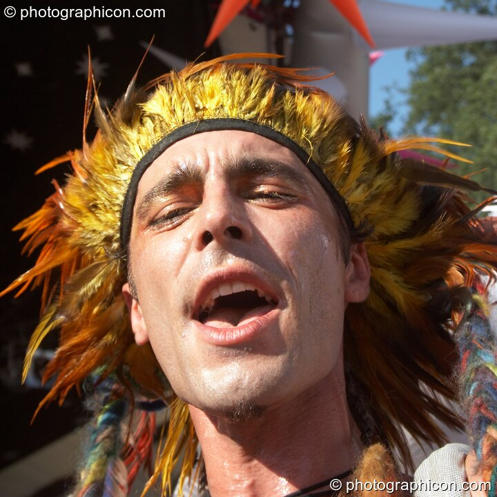 Sedek dances in colourful costume by the Origin Stage at Glade Festival 2006. Aldermaston, Great Britain. © 2006 Photographicon
