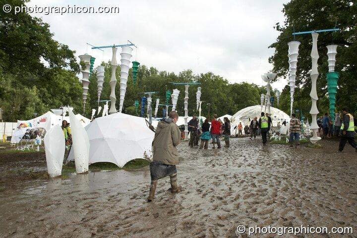 People walking in the mud around the IDspiral arena at Glade Festival 2007. Aldermaston, Great Britain. © 2007 Photographicon