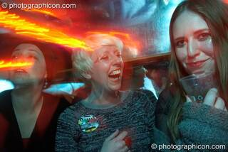 A group of women 'avin a laugh in the Boom Bus at Glade Festival 2011. King's Lynn, Great Britain. © 2011 Photographicon