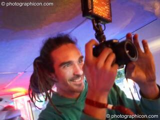 A smiling photographer in the Boom Bus at Glade Festival 2011. King's Lynn, Great Britain. © 2011 Photographicon