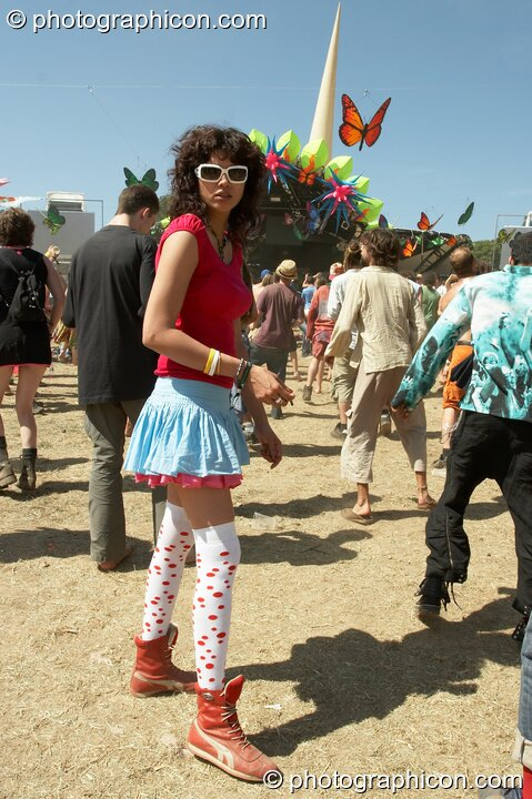 Girl in leggings and sunglasses looks back while dancing at Glade Festival 2005. Aldermaston, Great Britain. © 2005 Photographicon