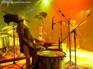 A masked African drummer performs with Juno Reactor on the Glade Stage at Glade Festival 2006. Aldermaston, Great Britain. © 2006 Photographicon