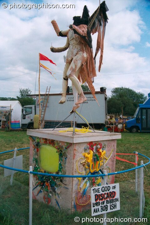 A statue of The God of Discard at Glastonbury Festival 2002. Pilton, Great Britain. © 2002 Photographicon