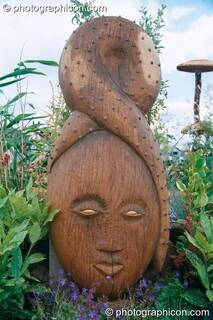 A wooden carving of a woman's head at Glastonbury Festival 2002. Pilton, Great Britain. © 2002 Photographicon