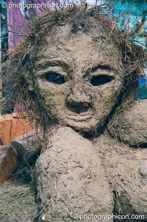 A clay and straw sculpture of a pregnant woman that is also a bread oven at Glastonbury Festival 2002. Pilton, Great Britain. © 2002 Photographicon