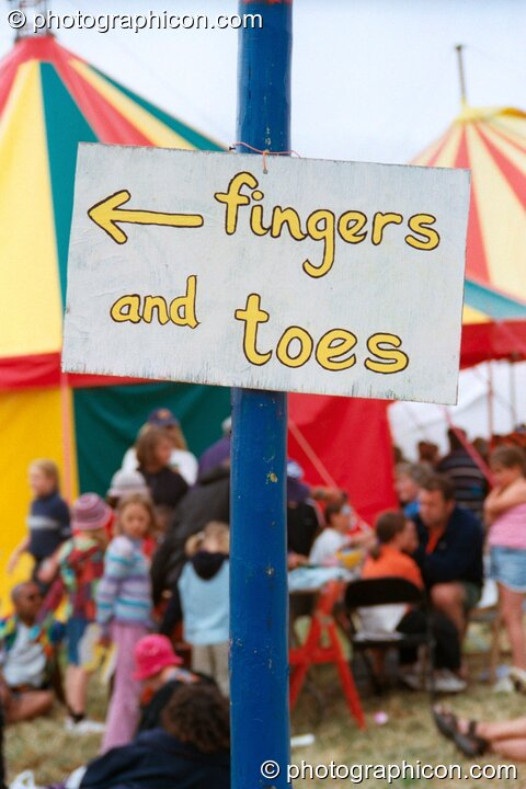 Fingers and toes sign at Glastonbury Festival 2002. Pilton, Great Britain. © 2002 Photographicon