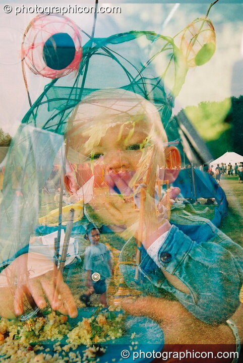 An accidental double-exposure of a child at Glastonbury Festival 2003. Pilton, Great Britain. © 2003 Photographicon