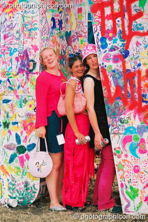 Three women posing amongst the letters of Hugh Jart's Love sculpture at Glastonbury Festival 2003. Pilton, Great Britain. © 2003 Photographicon