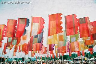 Many large flags decorate the Jazz Field at Glastonbury Festival 2003. Pilton, Great Britain. © 2003 Photographicon