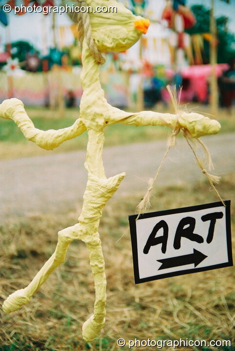 A stick figure holding an Art sign at Glastonbury Festival 2003. Pilton, Great Britain. © 2003 Photographicon
