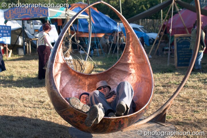 Suspended seat sculptures at Glastonbury Festival 2004. Pilton, Great Britain. © 2004 Photographicon