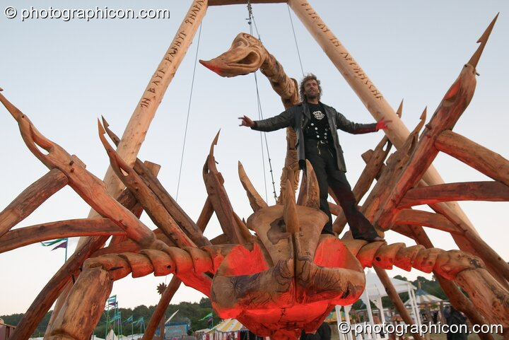A member of the Tree Pirates on top of their 25 foot Scorpion chainsaw sculpture at Glastonbury Festival 2004. Pilton, Great Britain. © 2004 Photographicon