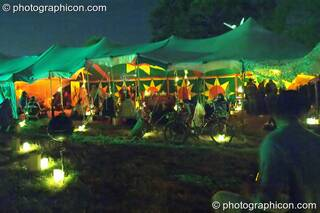 Outside the Small World Stage by candle light at Glastonbury Festival 2004. Pilton, Great Britain. © 2004 Photographicon