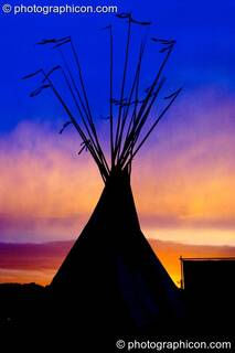 An tipi against a colour-manipulated dawn sky at Glastonbury Festival 2004. Pilton, Great Britain. © 2004 Photographicon