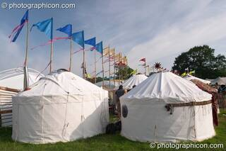 A row of yurts and flags in the Green Futures field at Glastonbury Festival 2005. Pilton, Great Britain. © 2005 Photographicon