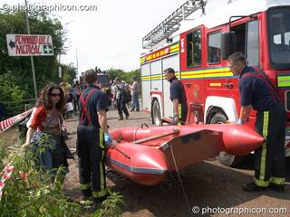 Somerset Fire Brigade arrive with a rescue raft after the Pennard Hill camp site flooded at Glastonbury Festival 2005. Pilton, Great Britain. © 2005 Photographicon