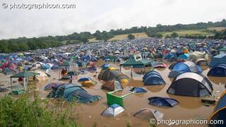 Partially submerged tents after the Pennard Hill camp site flooded at Glastonbury Festival 2005. Pilton, Great Britain. © 2005 Photographicon