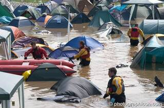 Somerset Fire Brigade search partially submerged tents after the Pennard Hill camp site flooded at Glastonbury Festival 2005. Pilton, Great Britain. © 2005 Photographicon