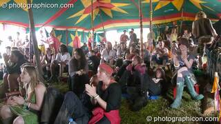 The audience cheers Martha Tilston on the Small World Stage (Green Futures field) at Glastonbury Festival 2005. Pilton, Great Britain. © 2005 Photographicon