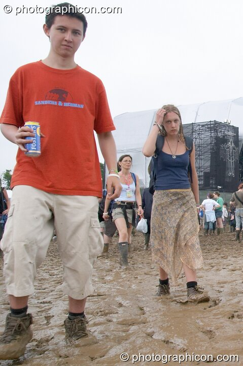 People walking through a lake of mud around the Other Stage at Glastonbury Festival 2005. Pilton, Great Britain. © 2005 Photographicon