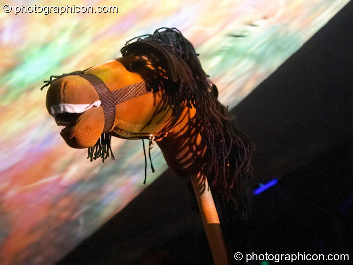 A toy horse head in front of projection screen in the idSpiral dome (Dance Village) at Glastonbury Festival 2005. Pilton, Great Britain. © 2005 Photographicon