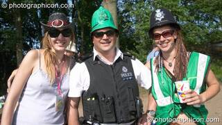 As a mark of respect, Somerset Constabulary swap helmets with the Green Police at Glastonbury Festival 2005. Pilton, Great Britain. © 2005 Photographicon