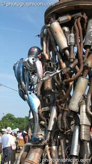 Mutoid Waste Company sculpture of a robot climbing a mountain made from car parts at Glastonbury Festival 2005. Pilton, Great Britain. © 2005 Photographicon